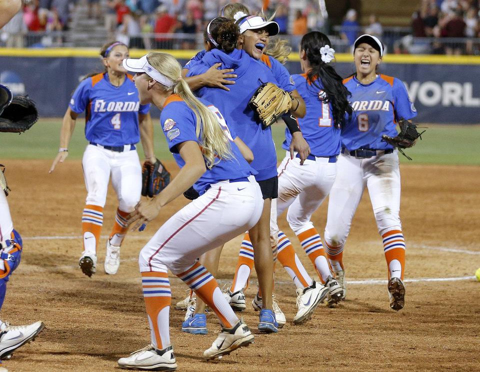 The Florida team including Stephanie Tofft, center facing camera, react after beating Nebraska in the fifteenth inning of their the Women's College World Series softball game at ASA Hall of Fame Stadium in Oklahoma City, Saturday, June, 1, 2013. Photo by Bryan Terry, The Oklahoman