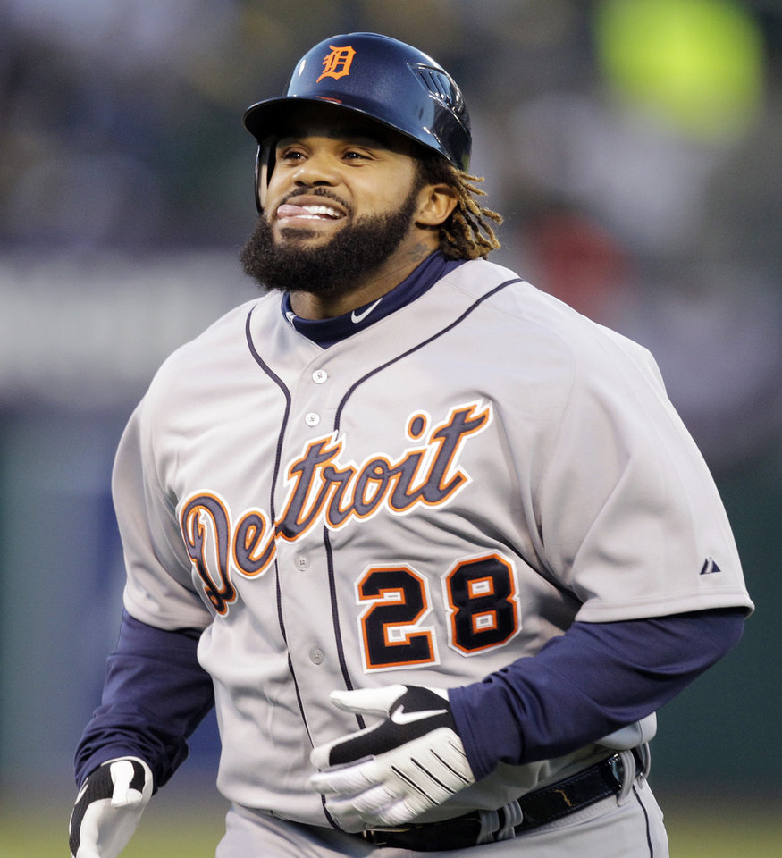 Detroit Tigers' Prince Fielder returns to the dugout after Oakland Athletics' Coco Crisp made a catch at the top of the wall for the out on a ball hit by Fielder in the second inning of Game 3 of an American League division baseball series in Oakland, Calif., Tuesday, Oct. 9, 2012. (AP Photo/Ben Margot)