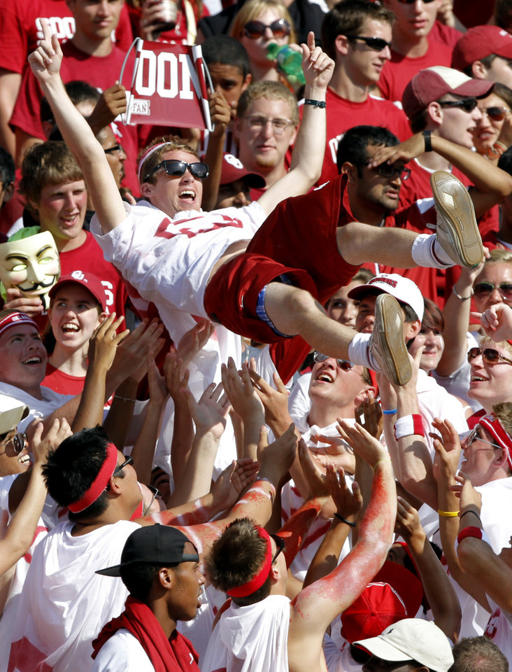 Photo - Sooner fans celebrate in the stands during the first half of the college football game between the University of Oklahoma Sooners (OU) and the Florida State University Seminoles (FSU) on Sat., Sept. 11, 2010, in Norman, Okla.  Photo by Chris Landsberger, The Oklahoman