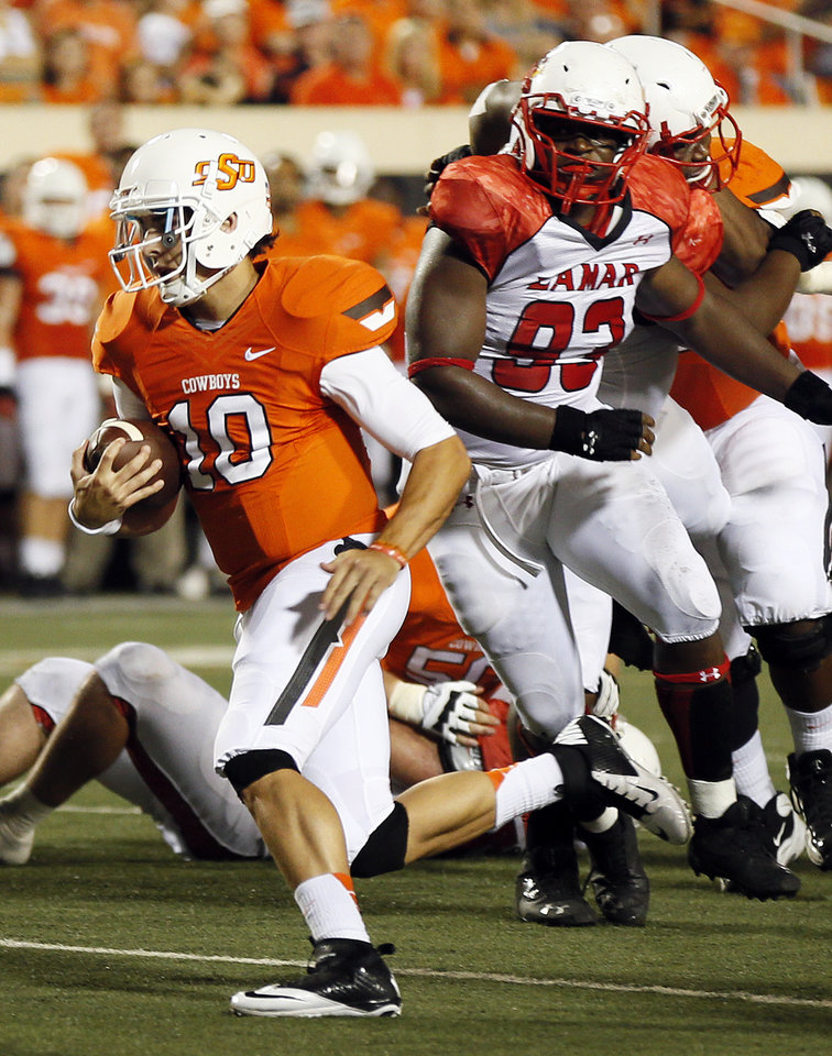 Photo - Oklahoma State's Clint Chelf (10) rushes for a touchdown in the third quarter during a college football game between the Oklahoma State University Cowboys (OSU) and the Lamar University Cardinals at Boone Pickens Stadium in Stillwater, Okla., Saturday, Sept. 14, 2013. Photo by Nate Billings, The Oklahoman