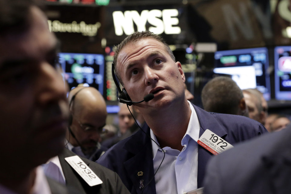 Photo - Trader Jonathan Corpina works on the floor of the New York Stock Exchange Friday, Aug. 1, 2014.  U.S. markets steadied on Friday a day after a major sell-off. Investors focused on a relatively strong jobs report, which showed the U.S. economy created 209,000 jobs in July, the sixth straight month of job growth above 200,000. (AP Photo/Richard Drew)