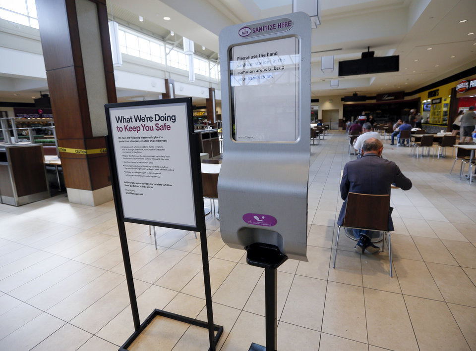 Photo - A hand sanitizer station near the food court at Penn Square Mall during the re-opening of the mall after being closed because of the coronavirus pandemic, in Oklahoma City, Friday, May 1, 2020. [Nate Billings/The Oklahoman]