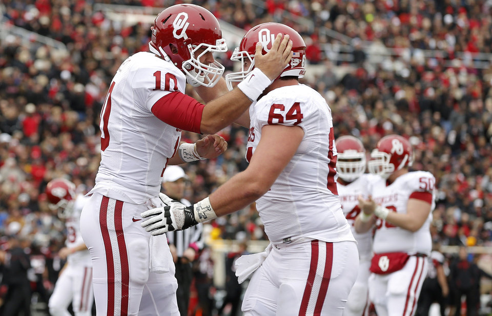 Oklahoma's Blake Bell (10) celebrates after a touchdown with Oklahoma's Gabe Ikard (64) during a college football game between the University of Oklahoma (OU) and Texas Tech University at Jones AT&T Stadium in Lubbock, Texas, Saturday, Oct. 6, 2012. Oklahoma won 41-20. Photo by Bryan Terry, The Oklahoman