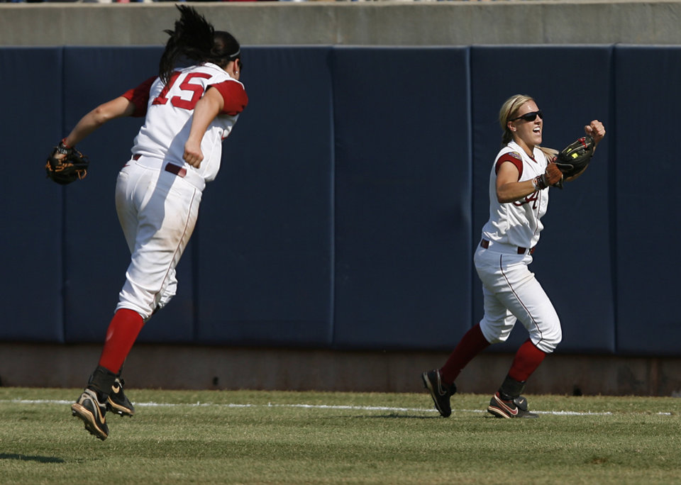 Jazlyn Lunceford (2) and Danae Hays (15) celebrate a win against California during a Women\'s College World Series game at ASA Hall of Fame Stadium in Oklahoma City, Sunday, June 3, 2012. Photo by Garett Fisbeck, The Oklahoman