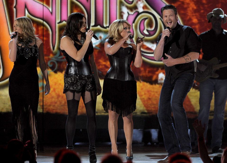 From left, Ashley Monroe, Angaleena Presley and Miranda Lambert of musical group Pistol Annies, and singer Blake Shelton perform at the 48th Annual Academy of Country Music Awards at the MGM Grand Garden Arena in Las Vegas on Sunday, April 7, 2013. (Photo by Chris Pizzello/Invision/AP) ORG XMIT: NVPM218