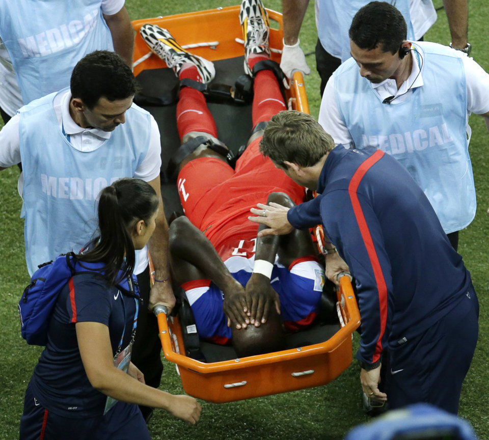 Photo - United States' Jozy Altidore is carried off the field during the group G World Cup soccer match between Ghana and the United States at the Arena das Dunas in Natal, Brazil, Monday, June 16, 2014. (AP Photo/Hassan Ammar)