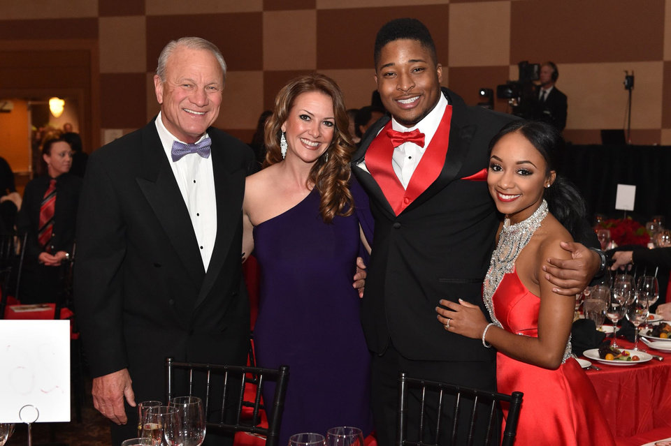 Photo -  From left, former University of Oklahoma football coach Barry Switzer, Kelli Masters, Corey Nelson and Jordan Dixon were among those in attendance.