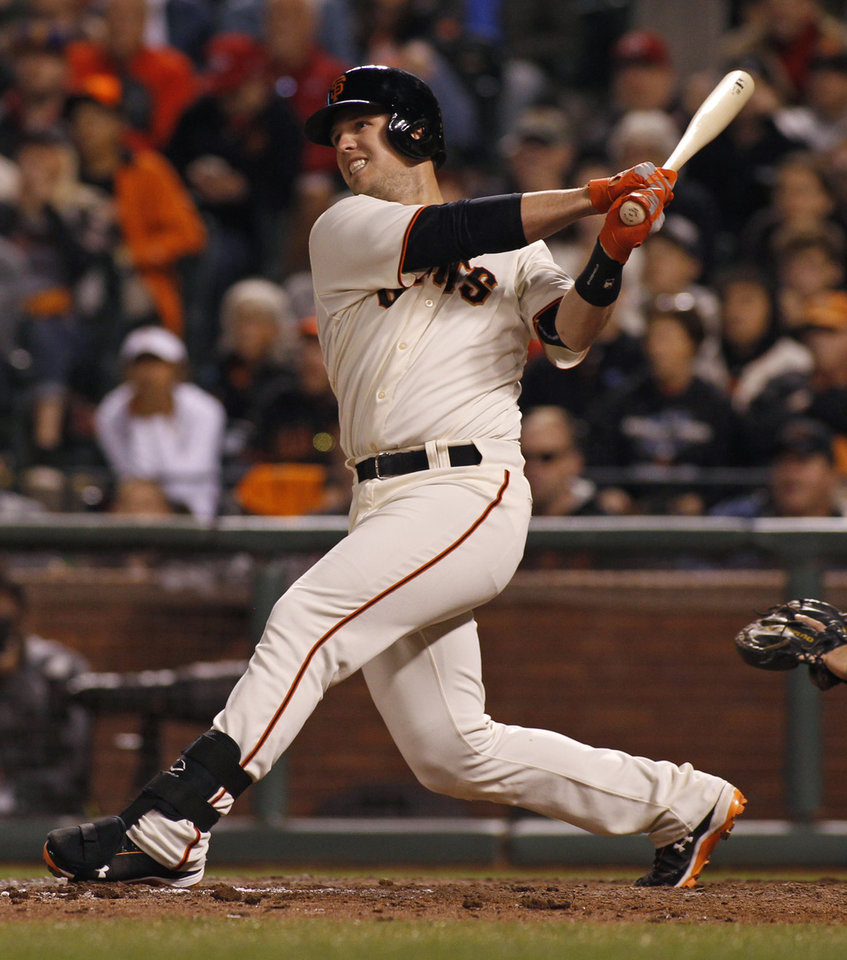 Photo - San Francisco Giants' Buster Posey hits an RBI double to tie the game against the Cincinnati Reds during the ninth inning of a baseball game, Saturday, June 28, 2014, in San Francisco.  (AP Photo/George Nikitin)