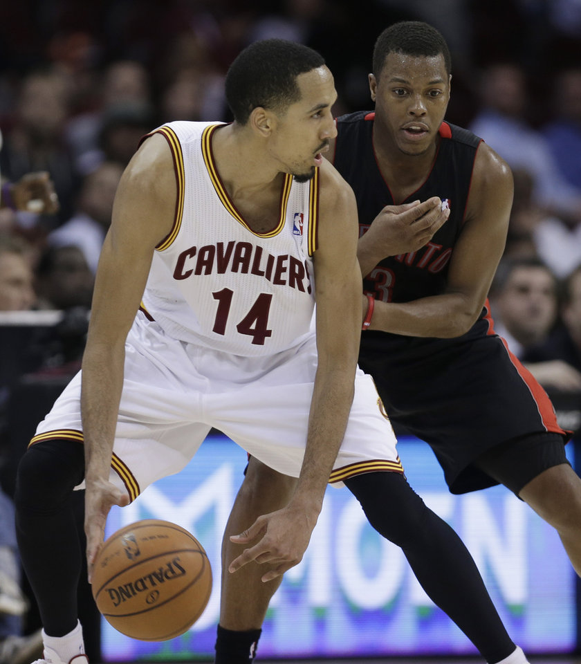 Cleveland Cavaliers' Shaun Livingston (14) works against Toronto Raptors' Kyle Lowry during the fourth quarter of an NBA basketball game Wednesday, Feb. 27, 2013, in Cleveland. The Cavaliers won 103-92. (AP Photo/Tony Dejak)