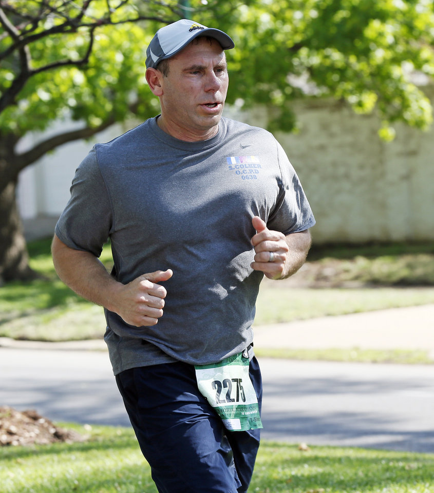 Photo - Rick Yerkes runs through Heritage Hills during the Oklahoma City Memorial Marathon in Oklahoma City, Sunday, April 28, 2013. Photo by Nate Billings, The Oklahoman