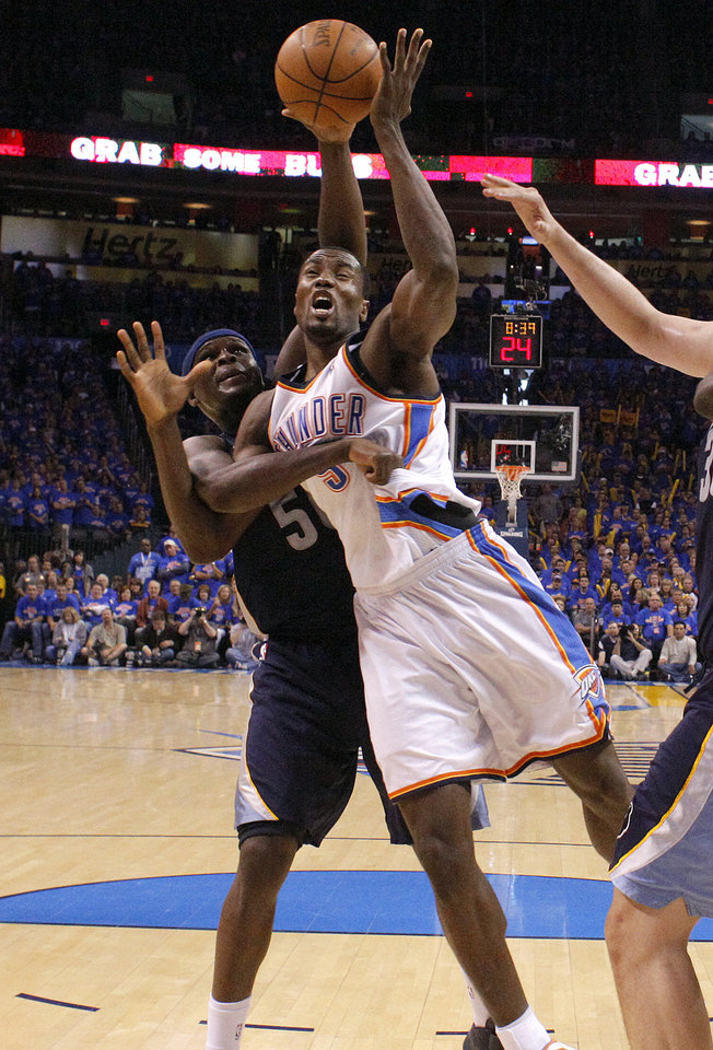 Oklahoma City's Serge Ibaka (9) shoots a layup as Zach Randolph (50) of Memphis defends him during game 7 of the NBA basketball Western Conference semifinals between the Memphis Grizzlies and the Oklahoma City Thunder at the OKC Arena in Oklahoma City, Sunday, May 15, 2011. Photo by Sarah Phipps, The Oklahoman