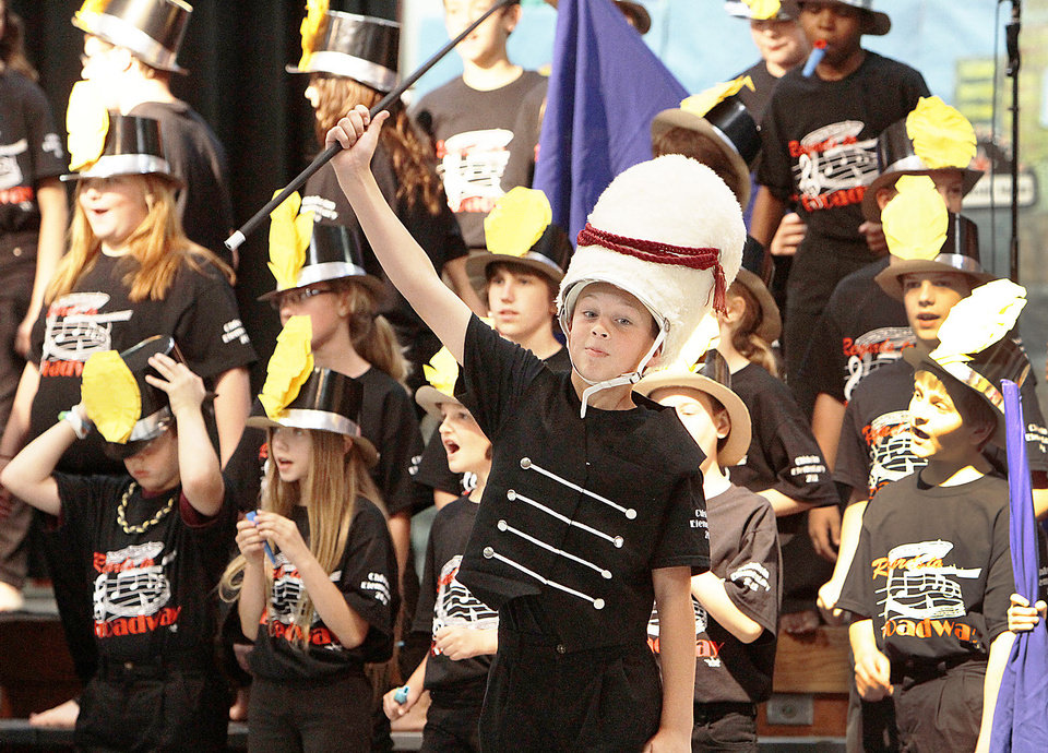 "Photo - Grayson Ramer leads the band in a number from ""The Music Man."""