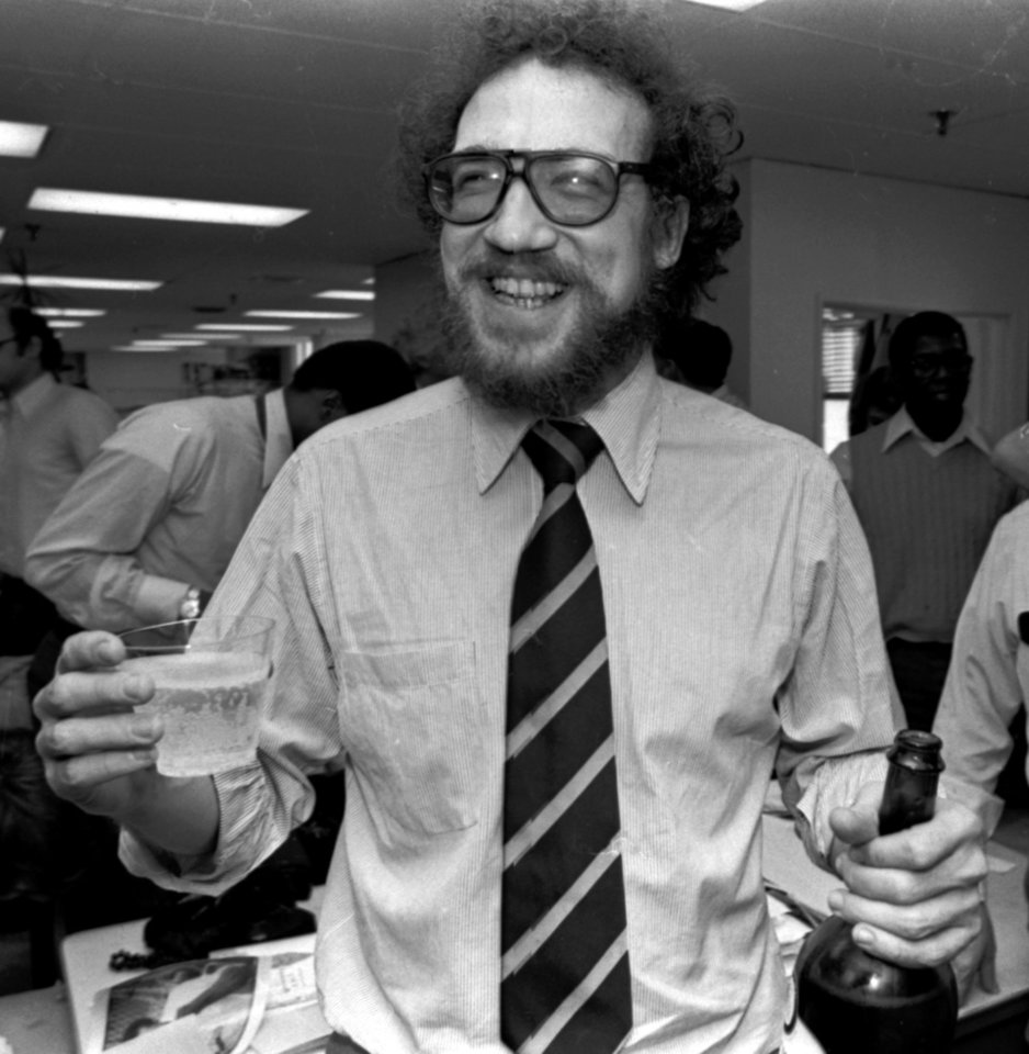 FILE - In an April 16, 1979 file photo, The Philadelphia Inquirer\'s Richard Ben Cramer celebrates with colleagues in the Inquirer city room after winning the Pulitzer Prize for his reporting in the Middle East. Cramer, whose narrative non-fiction spanned presidential politics and the game of baseball, died Monday, Jan. 7, 2013 at Johns Hopkins Hospital in Baltimore from complications of lung cancer, says his agent, Philippa Brophy. He was 62. (AP Photo/File)