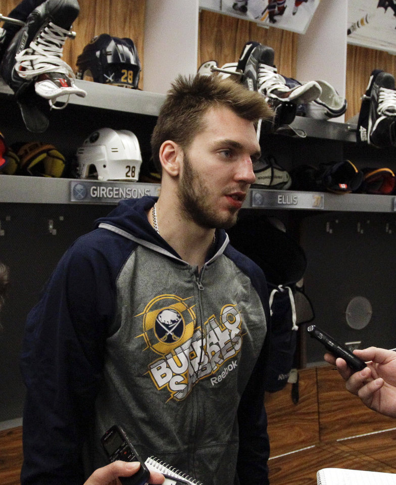 Photo - Buffalo Sabres center Zemgus Girgensons addresses the media during locker clean out day after players gathered for the last time on Monday, April 14, 2014, after the NHL hockey team clinched the NHL's worst record in Buffalo, N.Y. (AP Photo/Nick LoVerde)