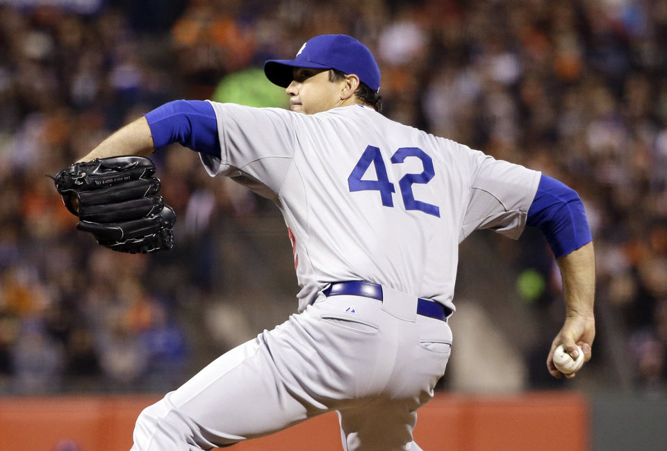 Photo - Los Angeles Dodgers starting pitcher Josh Beckett throws to the San Francisco Giants during the fourth inning of a baseball game on Tuesday, April 15, 2014, in San Francisco. (AP Photo/Marcio Jose Sanchez)
