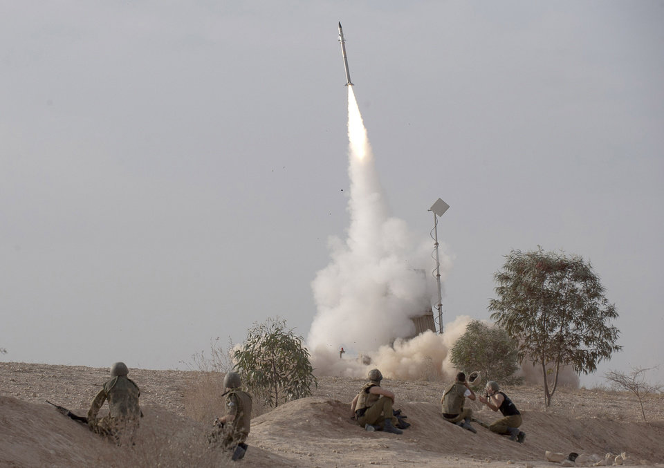Photo - FILE - In this Saturday, Nov. 17, 2012 file photo, an Israeli Iron Dome missile is launched near the city of Be'er Sheva, southern Israel, to intercept a rocket fired from Gaza. Israel's military has deployed Iron Dome defense system to the north of the country on Sunday May 5, 2013 following Israeli airstrikes in neighboring Syria targeting weapons believed to be destined for Lebanon's Hezbollah militants. Iron Dome protects against short-range rockets and Hezbollah has thousands of such projectiles. (AP Photo/Ahikam Seri, File)