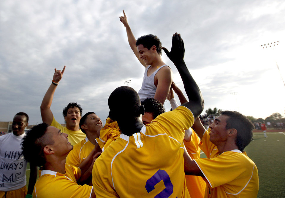 Northwest Classen lifts Juan Campos on their shoulders after he scored the winning goal in sudden death play during the boys 5A soccer state championship game between Northwest Classen and Cascia Hall at Edmond North High School in Edmond, Okla., Saturday, May 12, 2012. Photo by Sarah Phipps, The Oklahoman