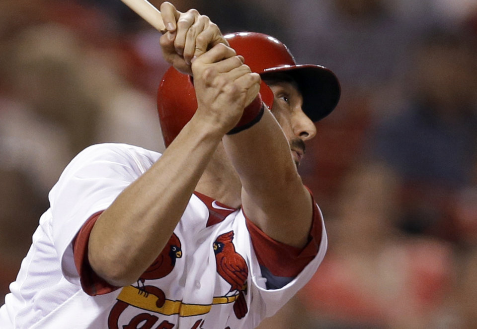 Photo - St. Louis Cardinals' Matt Carpenter watches his RBI single during the eighth inning of a baseball game against the Arizona Diamondbacks on Thursday, May 22, 2014, in St. Louis. (AP Photo/Jeff Roberson)