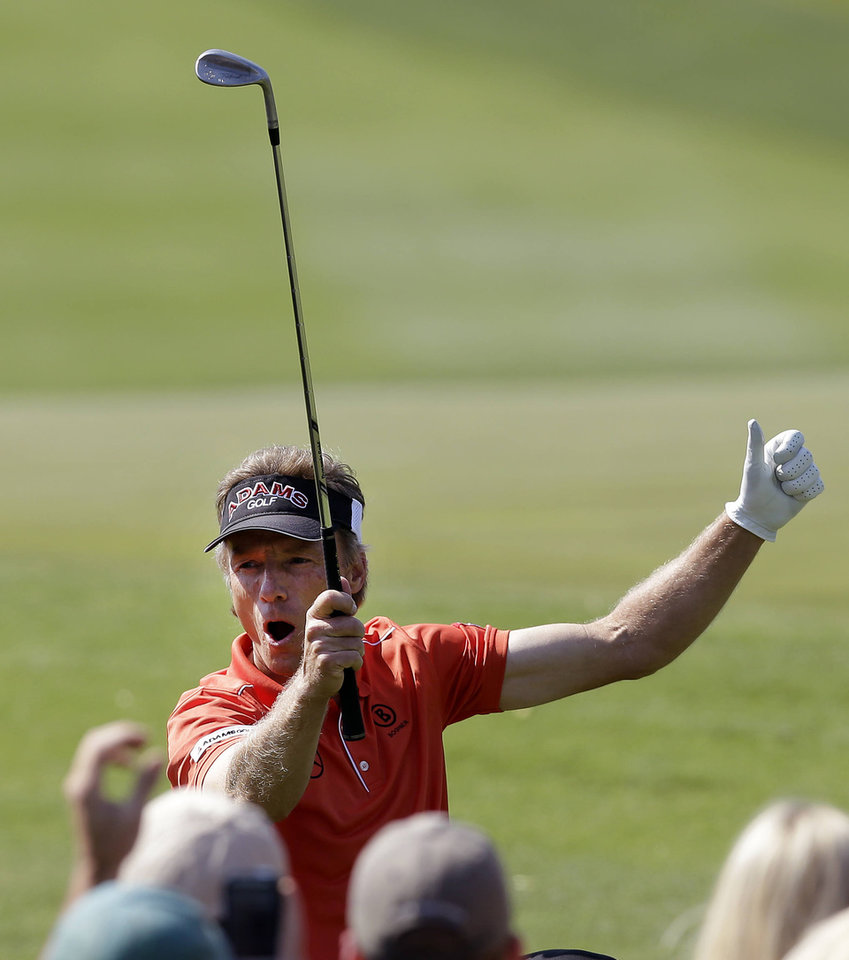 Photo - Bernhard Langer, of Germany, reacts after chipping in for a birdie on the 10th hole during the final round of the Greater Gwinnett Championship golf tournament on Sunday, April 21, 2013, in Duluth, Ga. (AP Photo/John Bazemore)