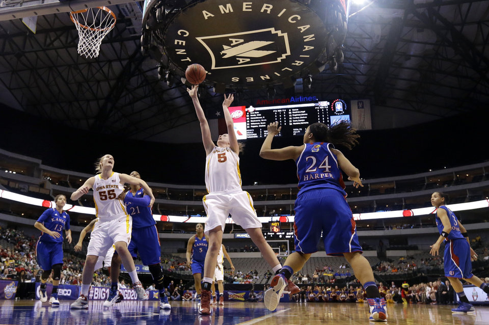 Photo - Iowa State's Hallie Christofferson (5) goes up for a shot past Kansas' CeCe Harper (24) as Iowa State's Anna Prins (55) watches during the first half of an NCAA college basketball game in the Big 12 women's tournament Saturday, March 9, 2013, in Dallas. (AP Photo/Tony Gutierrez)