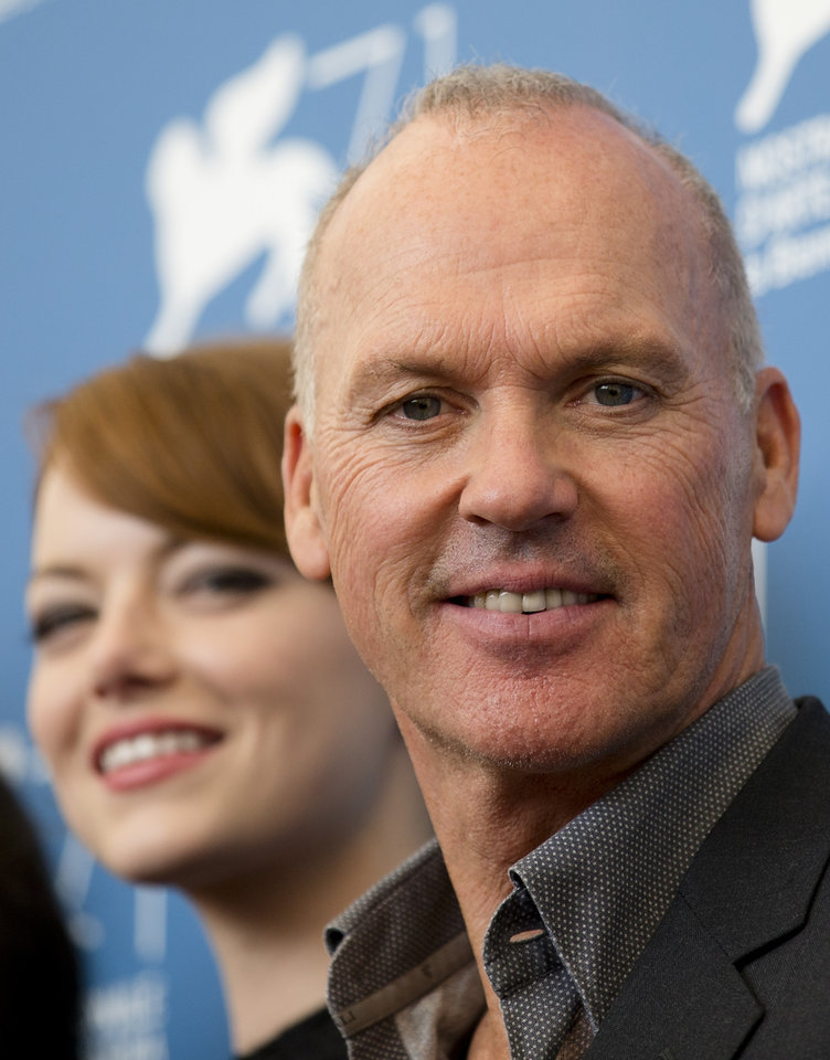 Photo - Actors Michael Keaton, right, and Emma Stone pose during a photo call for the movie Birdman at the 71st edition of the Venice Film Festival in Venice, Italy, Wednesday, Aug. 27, 2014. (AP Photo/Andrew Medichini)
