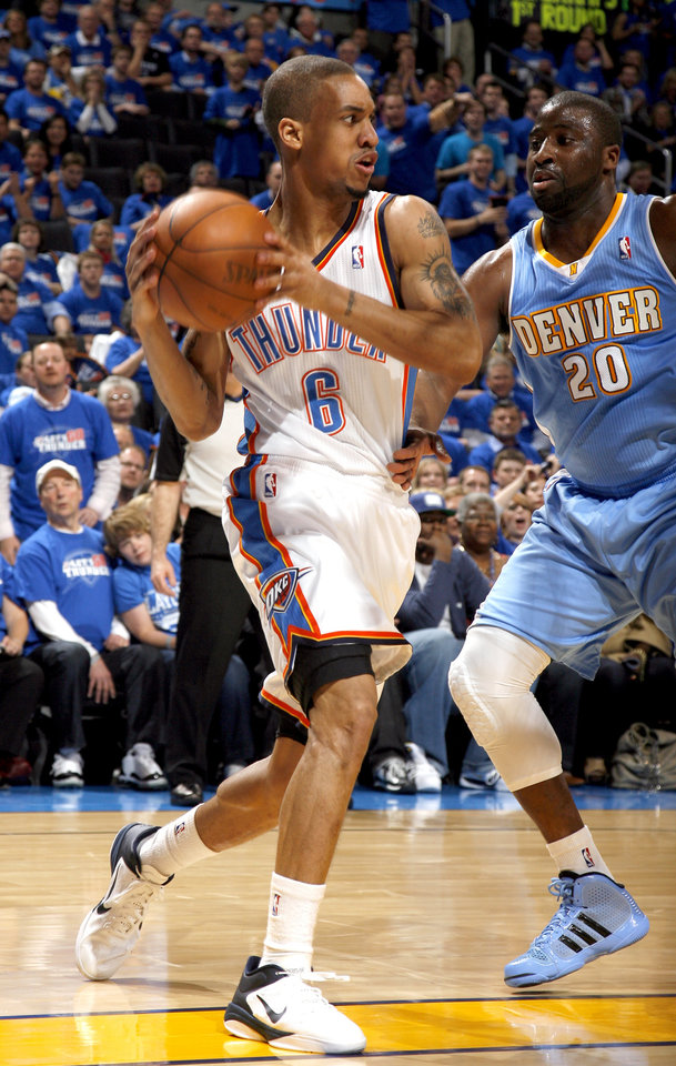 Photo - Oklahoma City's Eric Maynor (6) looks to pass around Denver's Raymond Felton (20) during the first round NBA basketball playoff game between the Oklahoma City Thunder and the Denver Nuggets on Wednesday, April 20, 2011, at the Oklahoma City Arena. Photo by Sarah Phipps, The Oklahoman