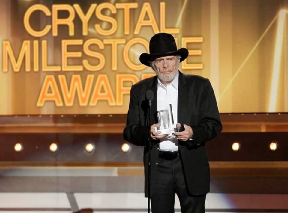 Photo -  Merle Haggard accepts the crystal milestone award at the 49th annual Academy of Country Music Awards at the MGM Grand Garden Arena on Sunday, April 6, 2014, in Las Vegas. (AP)