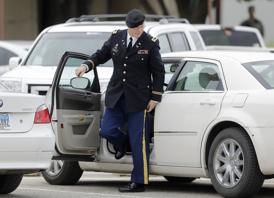 Photo - Defense attorney Lt. Col. Kris Poppe arrives at the Lawrence William Judicial Center as the sentencing phase for Maj. Nidal Hasan continues, Tuesday, Aug. 27, 2013, in Fort Hood, Texas. Hasan was convicted of killing 13 of his unarmed comrades in the deadliest attack ever on a U.S. military base. (AP Photo/Eric Gay)