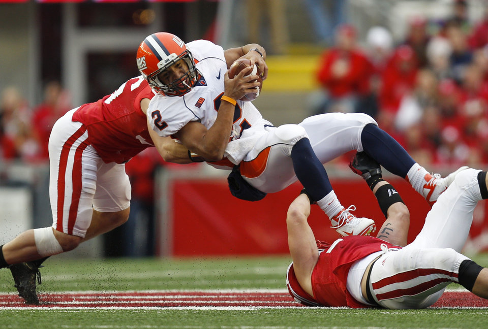 Illinois quarterback Nathan Scheelhaase (2) is tackled by Wisconsin's Ethan Armstrong, left, and Konrad Zagzebski during the second half of an NCAA college football game on Saturday, Oct. 6, 2012, in Madison, Wis. (AP Photo/Andy Manis)