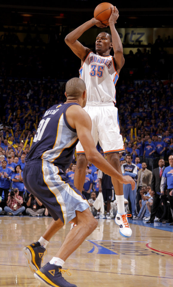 Oklahoma City's Kevin Durant (35) shoots a three-pointer as Shane Battier (31) of Memphis defends during game 7 of the NBA basketball Western Conference semifinals between the Memphis Grizzlies and the Oklahoma City Thunder at the OKC Arena in Oklahoma City, Sunday, May 15, 2011. Photo by Sarah Phipps, The Oklahoman