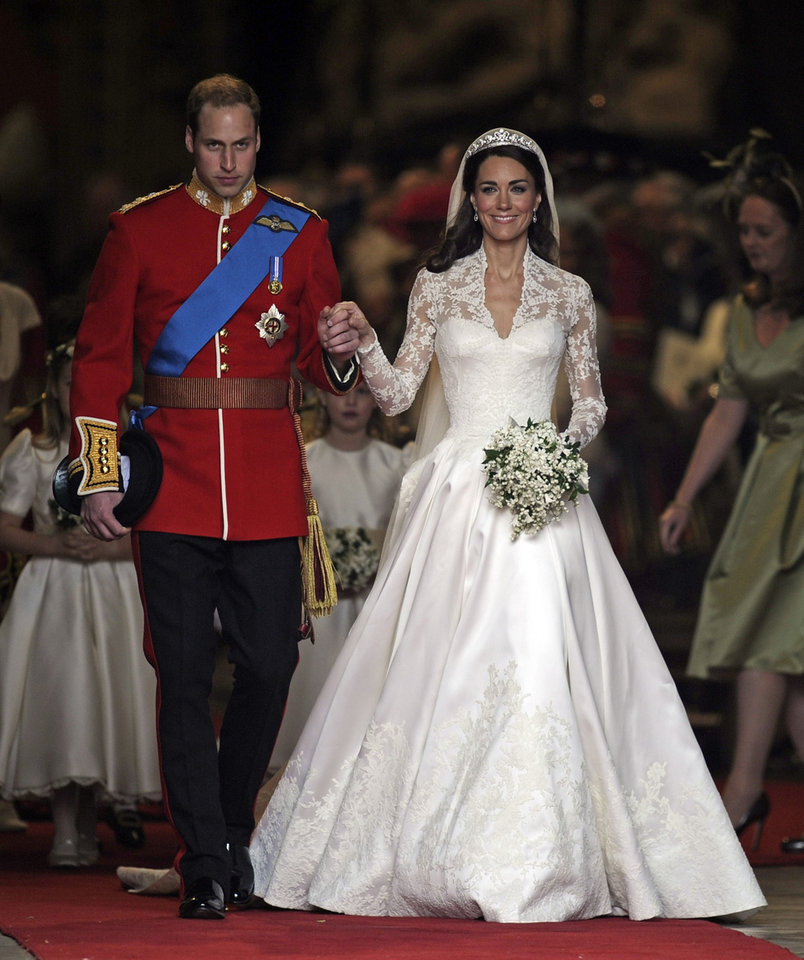 Photo - Britain's Prince William and his wife Kate, Duchess of Cambridge stand outside of Westminster Abbey after their Royal Wedding in London Friday, April, 29, 2011.  (AP Photo/Martin Meissner) ORG XMIT: RWMG142