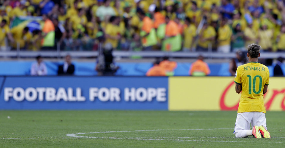Photo - Brazil's Neymar prays before a penalty shoot out at the end of the World Cup round of 16 soccer match between Brazil and Chile at the Mineirao Stadium in Belo Horizonte, Brazil, Saturday, June 28, 2014. Brazil won the match 3-2 on penalties after the match ended 1-1. (AP Photo/Andre Penner)