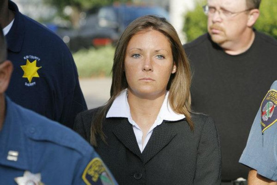 Raye Dawn Smith mother of Kelsey Smith-Brigg being escorted into the Kay County District Court in Newkirk for a hearing, Wednesday, September 12010.        Photo by David McDaniel, The Oklahoman ORG XMIT: KOD