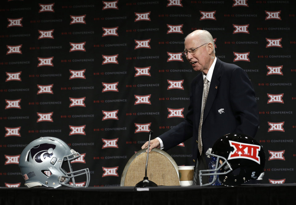 Photo - Kansas State head coach Bill Snyder arrives to speak to reporters at the Big 12 Conference NCAA college football media days in Dallas, Tuesday, July 22, 2014. (AP Photo)