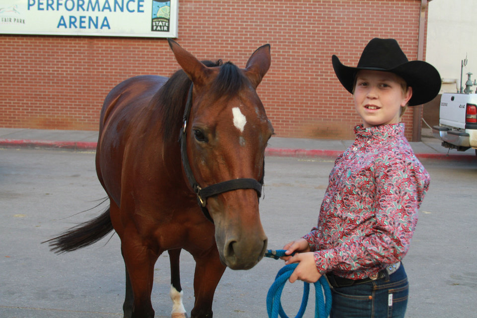 Hunter Bryant, 13, of Florida, one of the contestants at the American Quarter Horse Association�s World Championship Show in Oklahoma City, poses with his horse. Photo provided
