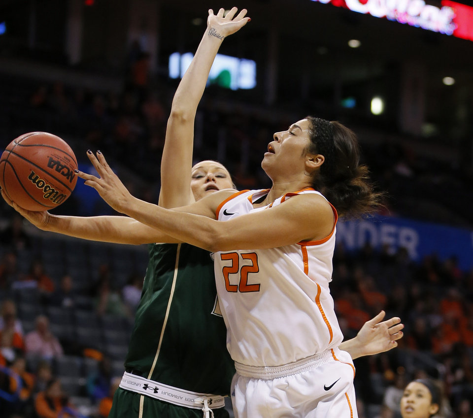 Photo - Oklahoma State's Brittney Martin (22) goes past Inga Orekhova (13) during the All-College Classic women's basketball game between Oklahoma State University and South Florida at Chesapeake Energy Arena in Oklahoma City, Okla., Saturday, Dec. 14, 2013. Photo by Bryan Terry, The Oklahoman