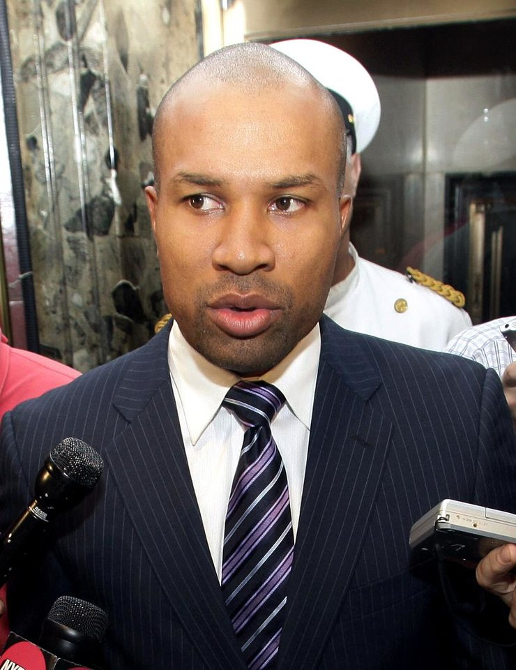 Photo - Derek Fisher, president of the NBA players union, talks with reporters, Monday, Oct. 10, 2011, in New York. NBA Commissioner David Stern canceled the first two weeks of the basketball season after players and owners were unable to reach a new labor deal to end the lockout. (AP Photo/David Karp) ORG XMIT: NYDK105