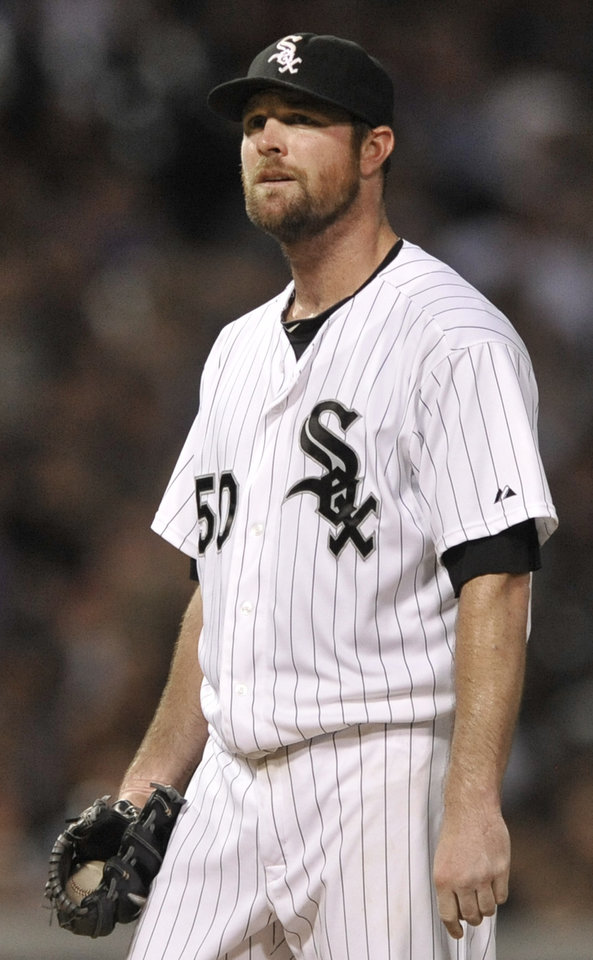 Photo - Chicago White Sox starting pitcher John Danks reacts to giving up a three-run home run to Atlanta Braves' Brian McCann during the sixth inning of a baseball game in Chicago, Friday, July 19, 2013. (AP Photo/Paul Beaty)
