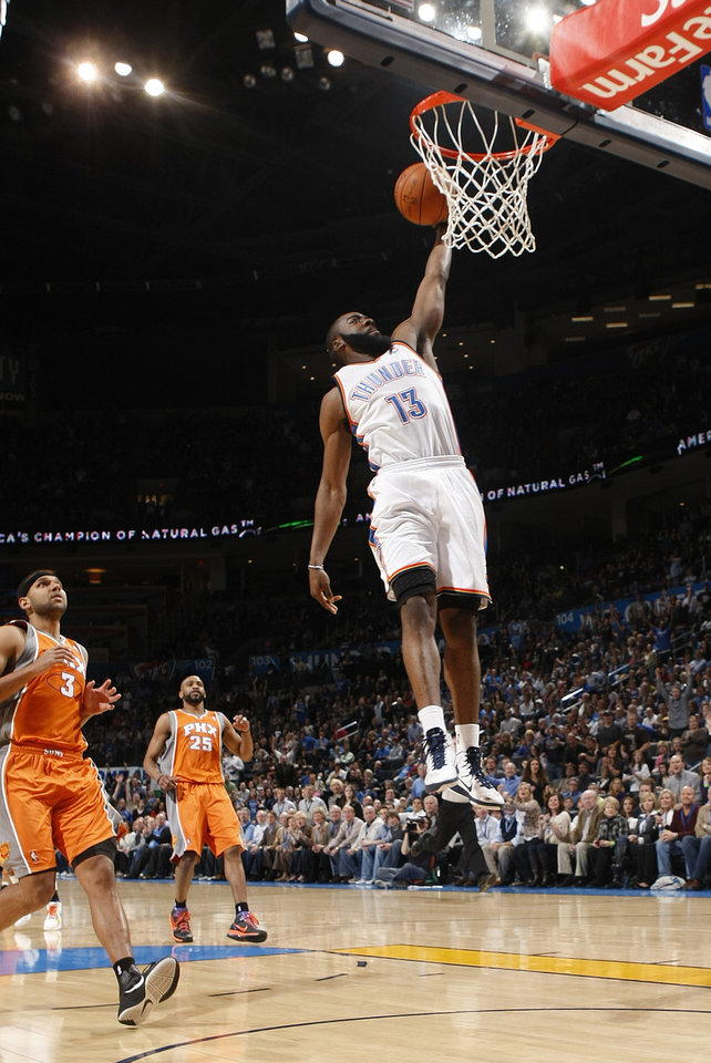 Oklahoma City's James Harden (13) dunks in front of Phoenix's Jared Dudley (3) and Vince Carter (25) during the NBA basketball game between the Oklahoma City Thunder and the Phoenix Suns, Sunday, March 6, 2011, the Oklahoma City Arena. Photo by Sarah Phipps, The Oklahoman