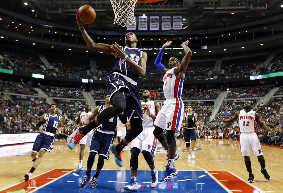 Oklahoma City Thunder forward Kevin Durant (35) drives on Detroit Pistons forward Josh Smith (6) in the first half of an NBA basketball game in Detroit, Friday, Nov. 8, 2013. (AP Photo/Paul Sancya)