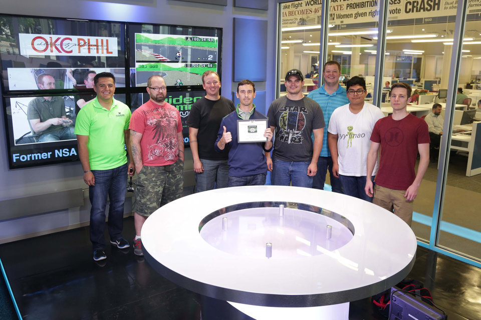 Photo -  Eight of the nine participants line up for a photo after The Oklahoman Mario Kart tournament on May 15, 2015. From left: Jesus Perez, Mark Ledlow, Shaun Wright, Sean Alexander, Matt Koivisto, Justin Curry, Luke Realrider and Gage Alleman.