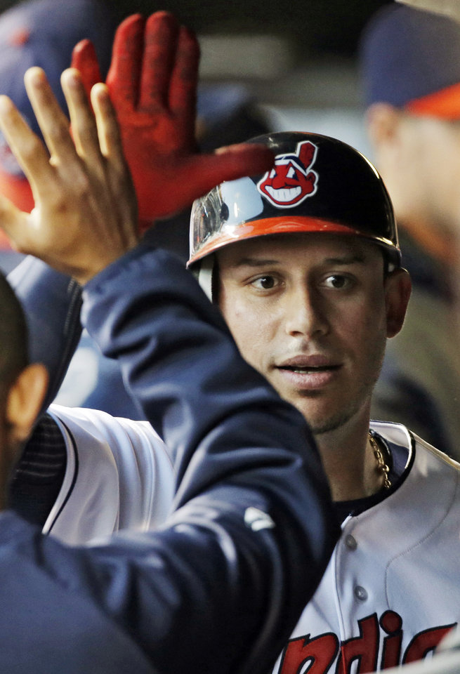 Photo -   Cleveland Indians' Asdrubal Cabrera is congratulated in thr dugout after a solo home run off Minnesota Twins starting pitcher Liam Hendriks in the first inning of a baseball game, Wednesday, Sept. 19, 2012, in Cleveland. (AP Photo/Mark Duncan)