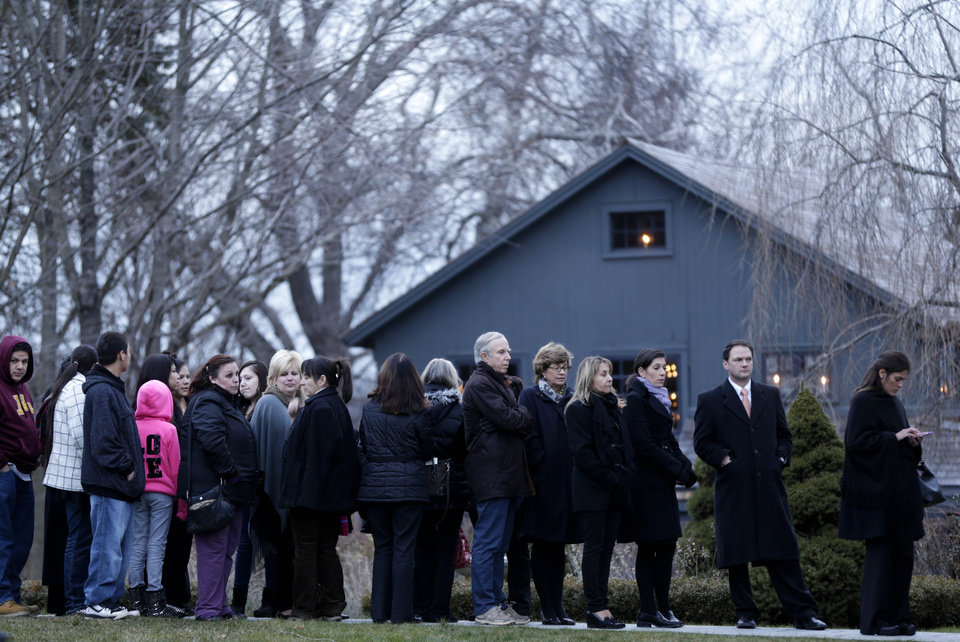 Photo - People stand in line to enter a funeral home for calling hours for Olivia Engel in Newtown, Conn., Thursday, Dec. 20, 2012. Engel, 6, was killed when Adam Lanza walked into Sandy Hook Elementary School in Newtown, Conn., Dec. 14, and opened fire, killing 26 people, including 20 children, before killing himself. (AP Photo/Seth Wenig)