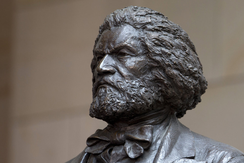 Photo - A bronze statue of 19th-century orator and writer Frederick Douglass can be seen in the Emancipation Hall of the United States Visitor Center on Capitol Hill in Washington. It was dedicated last June.  Carolyn Kaster - AP