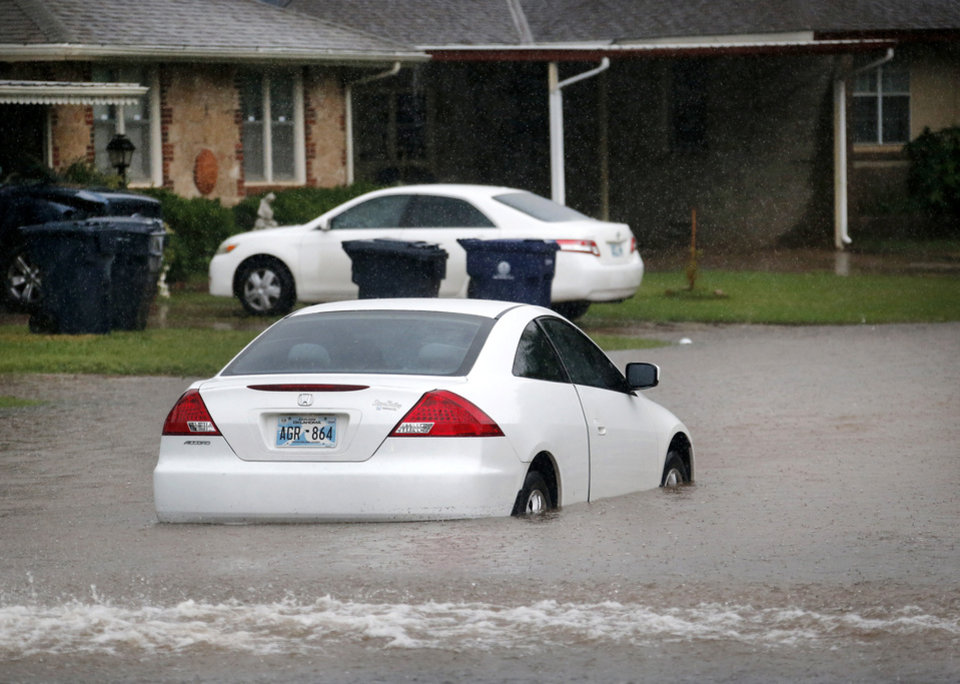 Photo - Heavy rains overwhelmed stormwater drainage systems and caused flooded streets, requiring  high water rescues in Oklahoma City as another round of severe storms passes through the metro.