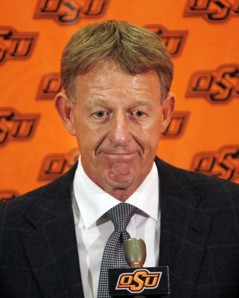 Photo - OSU, RESIGN: Oklahoma State University athletic director Mike Holder reacts during a press conference to announce the resignation of men's college basketball coach Sean Sutton on Tuesday, April 1, 2008, in Stillwater, Okla.  PHOTO BY CHRIS LANDSBERGER ORG XMIT: KOD