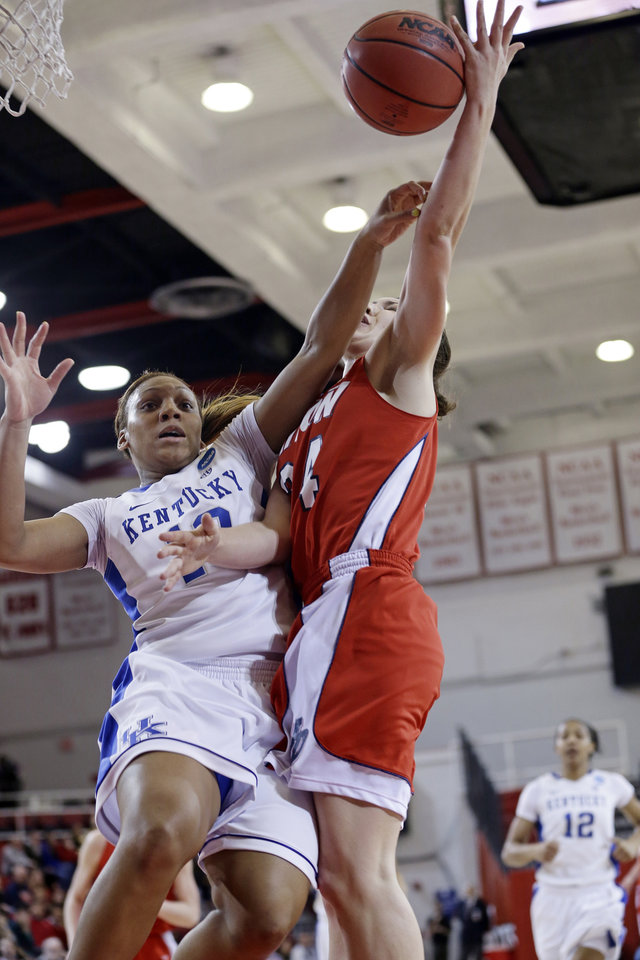 Kentucky's Bernisha Pinkett (10) fouls Dayton's Andrea Hoover (24) as Kentucky's Jelleah Sidney (12) trails the play in the first half of a second-round game in the NCAA women's college basketball tournament Tuesday, March 26, 2013, in New York. (AP Photo/Frank Franklin)