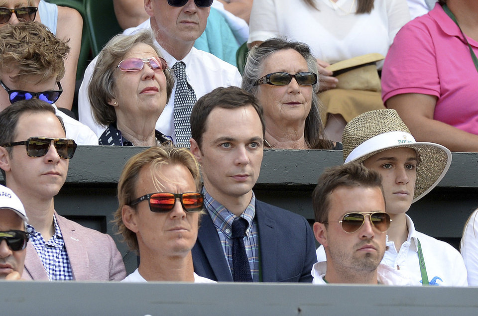 Photo - U.S. actor Jim Parsons, centre, watches from  the players box duirng the Wimbledon women's semifinal match between Canada's Eugenie Bouchard and  Romania's Simona Halep at the All England Lawn Tennis Championships in Wimbledon, London,  Thursday July 3, 2014. (AP Photo/Anthony Devlin/PA)  UNITED KINGDOM OUT