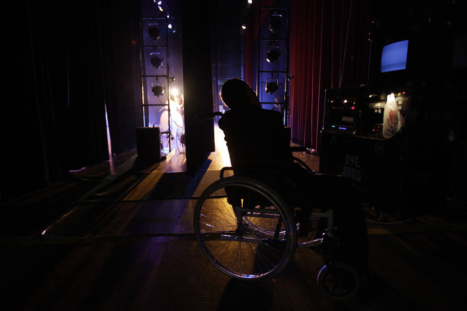"In this Sept. 21, 2012 photo, actor Juan Fernando waits backstage before his performance in ""Suenos,"" or �Dreams,� one of Ecuador's most successful musicals, at the Casa de la Cultura theater in Quito, Ecuador. The musical is based in part on the dreams of young people with disabilities and is presented by the nonprofit foundation El Triangulo. (AP Photo/Dolores Ochoa)"