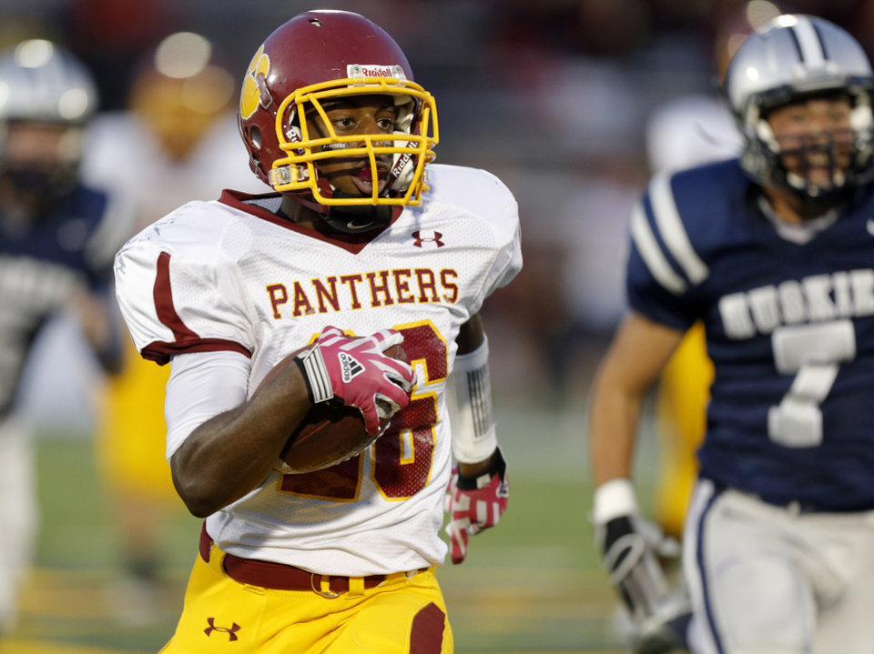 Photo - Putnam City North's Larry Butler runs against Edmond North during a high school football game at Wantland Stadium in Edmond, Okla., Friday, September 21, 2012. Photo by Bryan Terry, The Oklahoman